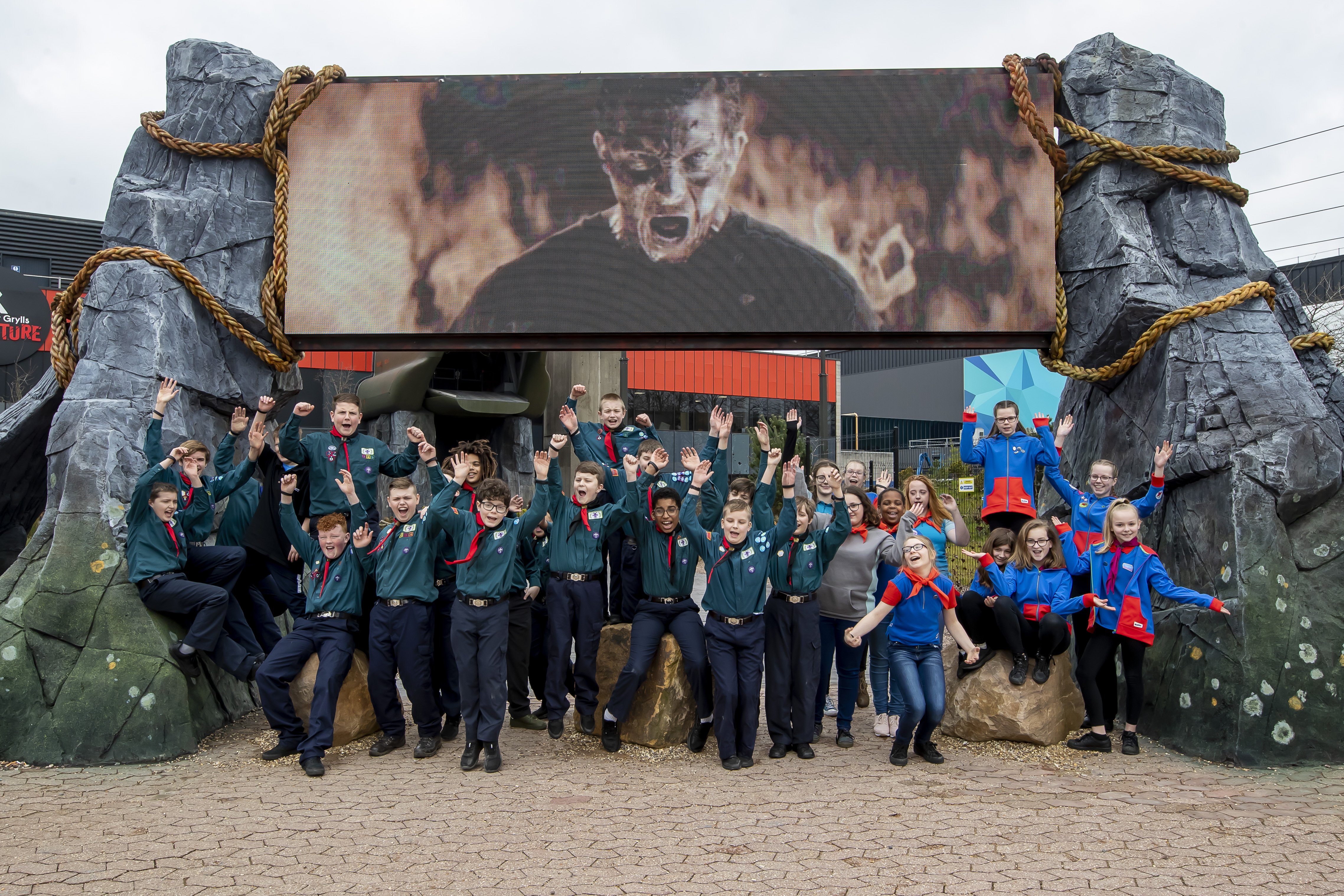 Group of scouts post by The Bear Grylls Adventure entrance